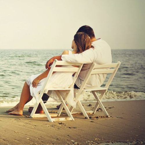 relaxed non-high maintenance woman enjoying with man on the beach